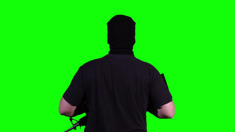 Man in Mask with Gun Watching Back Greenscreen 18 Stock Video Footage