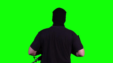 Man in Mask with Gun Watching Back Greenscreen 18 Footage