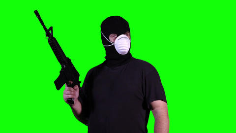 Man in Mask with Gun Watching Greenscreen 13 Stock Video Footage