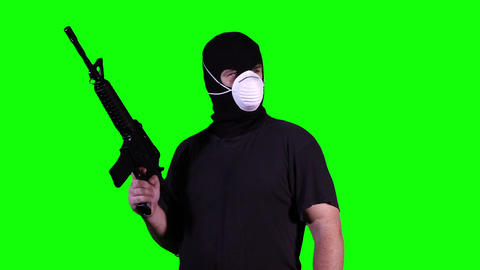 Man in Mask with Gun Watching Greenscreen 13 Footage