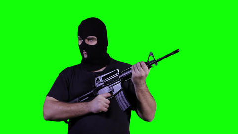 Man in Mask with Gun Watching Greenscreen 21 Footage