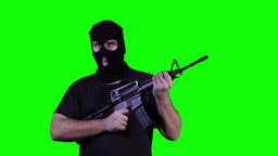 Man in Mask with Gun Watching Greenscreen 21 Stock Video Footage
