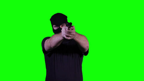 Man in Mask with Pistol Gun Action Greenscreen 25 Stock Video Footage