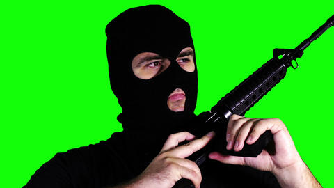 Man with Gun Reloading Closeup Greenscreen 60 Stock Video Footage
