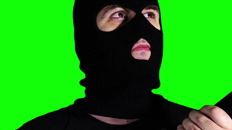 Man with Gun Watching Closeup Greenscreen 61 Stock Video Footage