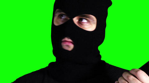 Man with Gun Watching Closeup Greenscreen 61 Footage