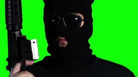 Man with Gun Watching Closeup Greenscreen 63 Stock Video Footage