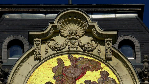 Mosaic icon on the facade of the building in Budapest Live Action