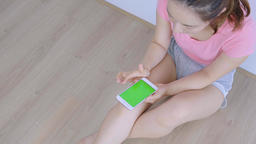 Young Woman Sitting On Floor Using Cellphone On Green Background At Home Live影片