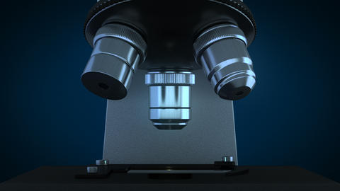 Scientific microscope in dark laboratory rotating its metal lenses Animation