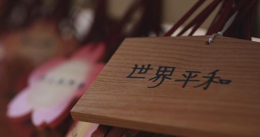 Votive tablets at Ikegami honmonji temple in Tokyo closeup handheld ライブ動画
