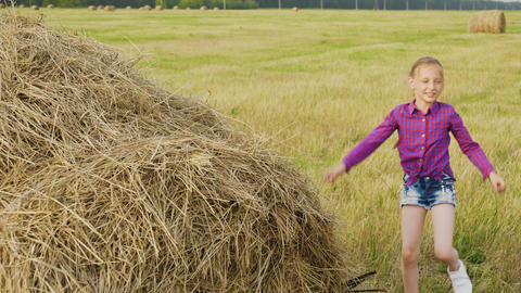 Active Little Girl Climbing on Haystack Sunny Day Footage