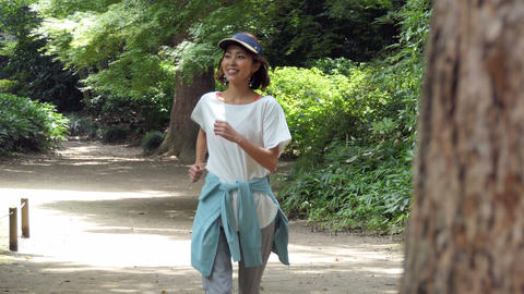 Woman Jogging In Park Doing Sport Activity For Fun Footage
