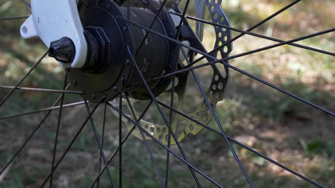 Modern bicycle tire with electric wheel led light and motor on the blurry Live Action