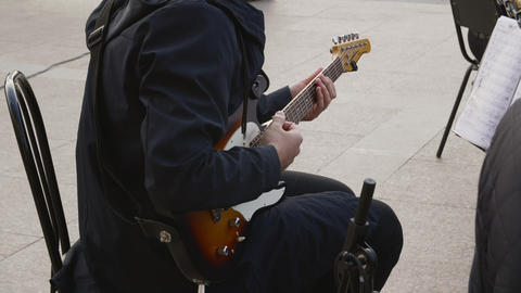 Guitar player playing rock music on outdoor performance. Musician playing music Footage