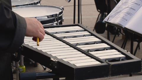 Male hands playing music on metallophone on outdoor concert. Musian playing Live Action
