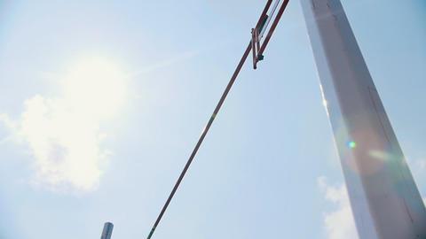 Pole vault training on the stadium outside - sunny weather Live Action