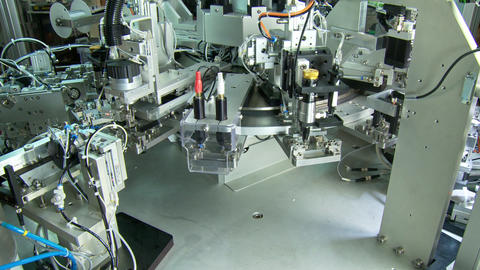 Advanced industrial production line for small parts, robotic arms working Footage