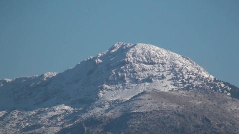 Snowy Mountain Top from Long Distance (2) Live Action