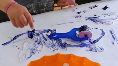Babies Playing with Paints in Kindergarten Childcare Filmmaterial