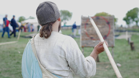BULGAR, RUSSIA 11-08-2019: A person throwing a spear and misses the target Live Action