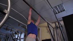 a powerful athlete of age performs a planche on a bar Footage