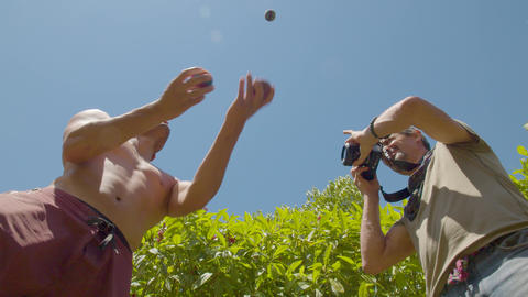 Professional Photographer Taking Photos Of A Juggler Low Angle In Ecuador Live Action
