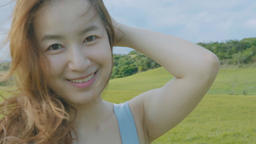 Beautiful Asian Female Enjoying Outdoor Life In The Grass Live Action