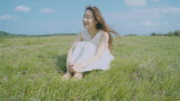 Beautiful Asian Female Enjoying Outdoor Life In The Grass Footage