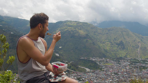 Tourist Man Eating His Lunch And Admiring The Landscape From A Mountain Footage