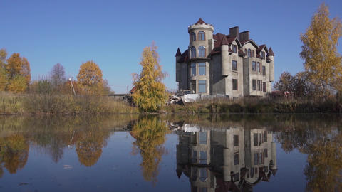 Beautiful dwelling mansion with nice pond in front of it located in country side Live Action