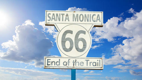 "Clouds passing over ""Route 66 end of the trail"" sign in Los Angeles, California Live Action"