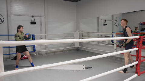 Two boxer man throwing ball while warming training on boxing ring. Fighter man Footage