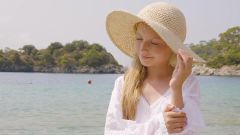 Portrait cute teenager girl in straw hat on blue sea background. at summer Footage