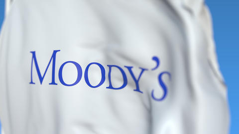 Waving flag with Moody's Corporation logo, close-up. Editorial loopable 3D Live Action