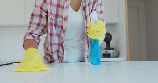 Cleaning the kitchen. Housekeeper washes the kitchen table Live Action