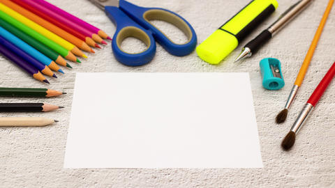 Stop motion animation of writing art time on paper and art supplies around Animation