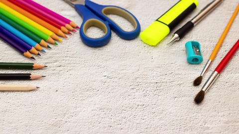 Paper with title back to school appear and moving surrounded with school supplies - Stop motion Animation
