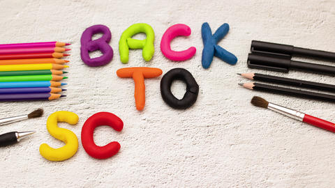 Back to school title appear on the desk surrounded with school supplies - Stop motion animation Animation