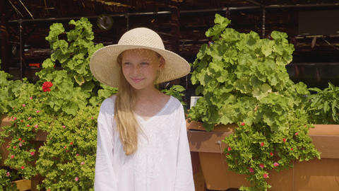 Portrait teenager girl in straw hat at sunny day in resort hotel. Smiling girl Live Action