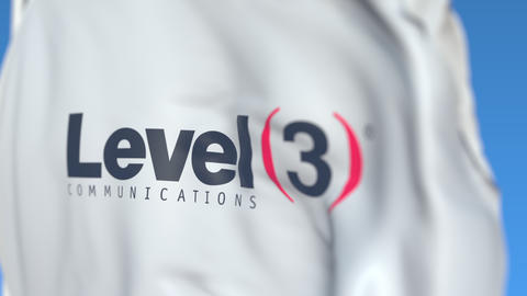 Flying flag with Level 3 Communications logo, close-up. Editorial loopable 3D Footage