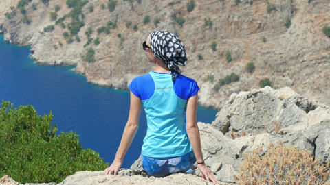 Young woman enjoying freedom and taking sun bath with beatiful viewn of Footage
