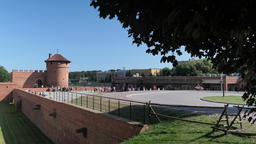 Fortification of Malbork castle and tourists next to the ticket office building Live Action