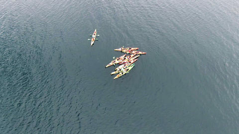 Aerial top view of kayak boat Tourist route several kayakers met among the sea Live Action