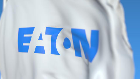 Flying flag with Eaton Corporation logo, close-up. Editorial loopable 3D Live Action