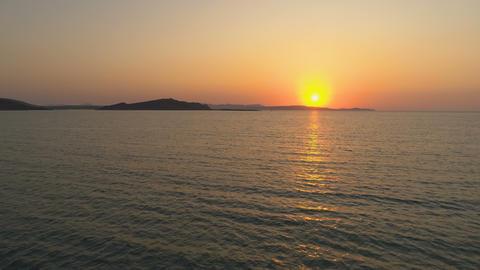 Orange and golden sunset over sea horizon in Greek island Footage