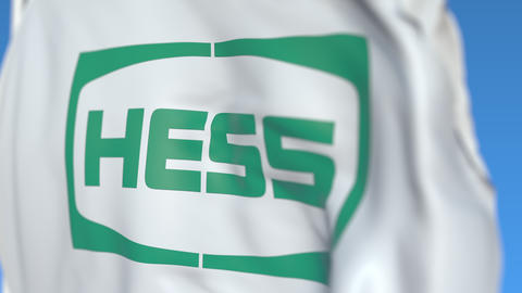 Waving flag with Hess Corporation logo, close-up. Editorial loopable 3D Live Action