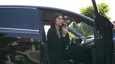 Beautiful young woman with long hair and business costume talking on phone and Live Action