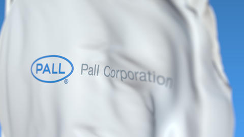Waving flag with Pall Corporation logo, close-up. Editorial loopable 3D Live Action