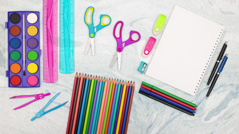 Stop motion animation of scissors and carpenters moving surrounded with school supplies Animation
